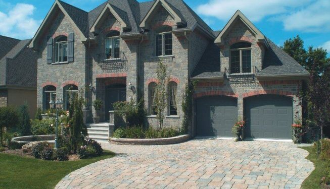 Brick walkway in front of beautiful home