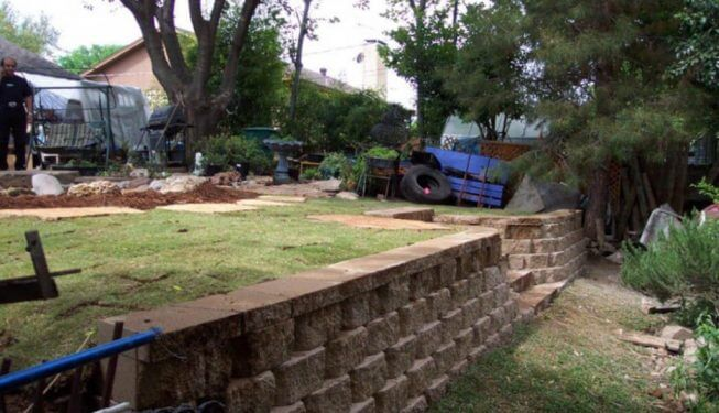Retaining wall separating parts of yard