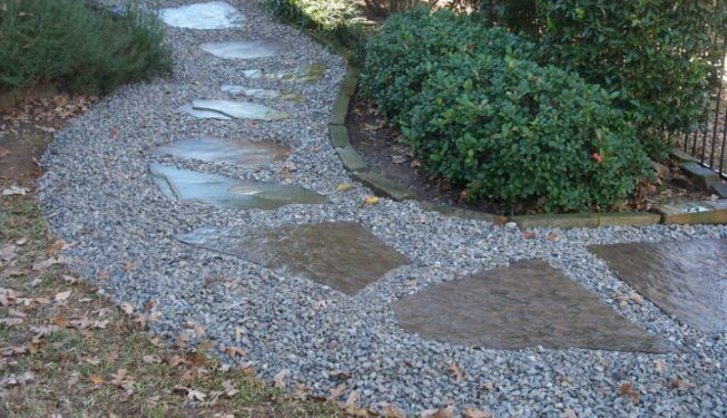Rock walkway curving around shrubs