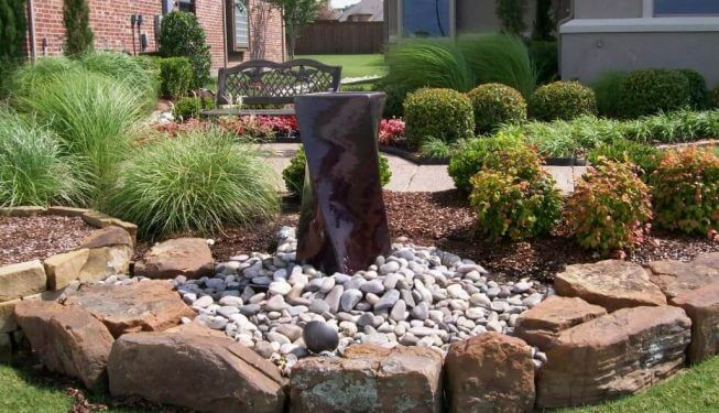 Modern landscaping with water feature