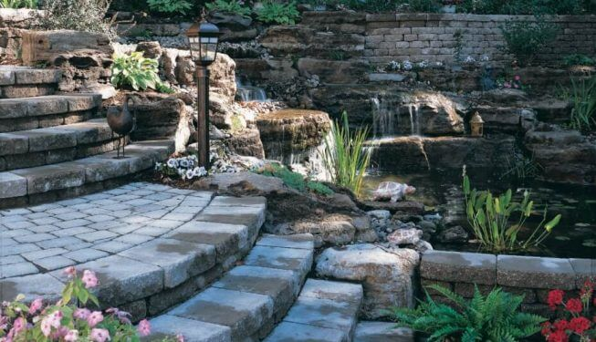 Brick walkway with steps by pond