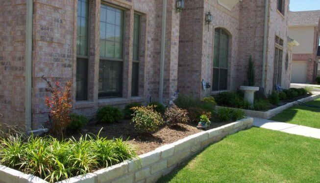 Retaining wall framing front yard plants